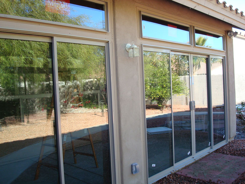 Patio enclosure with sliding glass doors.