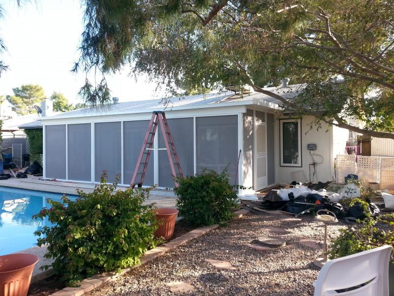 Screen room under Aluminum insulated patio roof