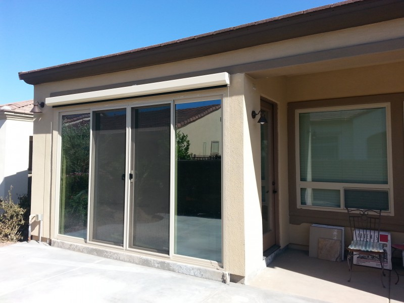 Using 12' by 8' sliding glass door as part of the patio enclosure. A roll down sunscreen is installed above the door.