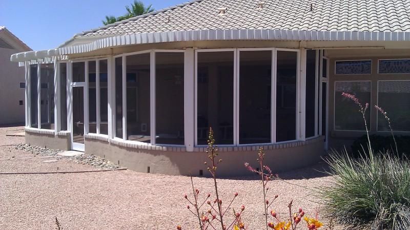 Patio screen enclosure under existing patio roof