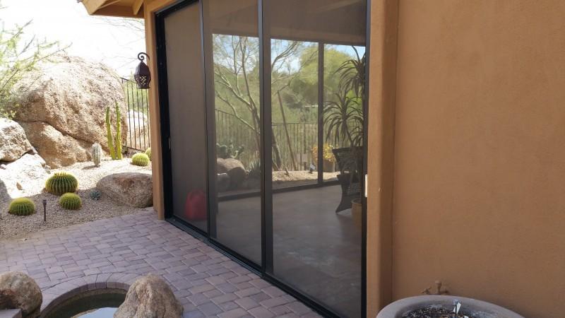 Screened patio using custom screen doors